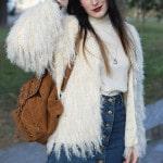 outfit seventies pellicciotto bianco stivaletti frange pittarello